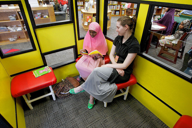 Abdulnas Ali reads to Amanda Stephen during the Reading Buddies program at the Karl Road Branch of the Columbus Metropolitan Library on Tuesday, May 5. The popular program pairs students in kinndergarten through third grade with volunteers who either listen to the students read or read to them. Abdulnas Ali reads to Amanda Stephen during the Reading Buddies program at the Karl Rd Library Tuesday, May 5, 2015.